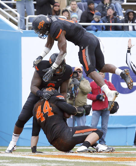 Oklahoma State&#039;s Jeremy Seaton (44), Kye Staley (9) and Oklahoma State&#039;s Joseph Randle (1) celebrate a Seaton touchdown during the Heart of Dallas Bowl football game between the Oklahoma State University (OSU) and Purdue University at the Cotton Bowl in Dallas,  Tuesday,Jan. 1, 2013. Photo by Sarah Phipps, The Oklahoman