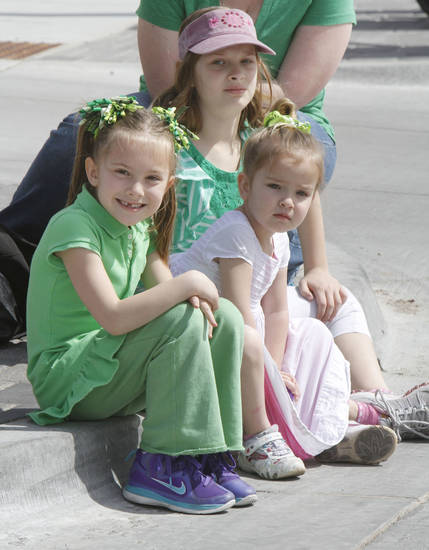 Sisters Teryn Manis, left, 6, Avery, 8, and Lillee, 4, watch the annual Saint Patrick's Day Parade in downtown Oklahoma City, OK, Saturday, March 16, 2013,  By Paul Hellstern, The Oklahoman