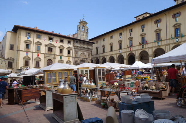 An antique fair sprawls across the Piazza Grande in Arezzo, Italy. (Photo by Tricia Tramel)