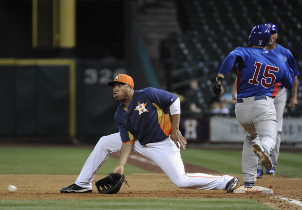 Houston Astros' Jonathan Singleton, left, makes the catch and the out on Chicago Cubs' Darwin Barney (15) in the eighth inning of an exhibition baseball game Friday, March 29, 2013, in Houston. (AP Photo/Pat Sullivan) ORG XMIT: HTA110