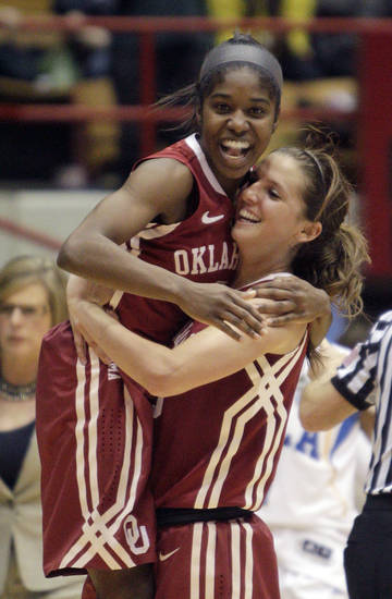 Oklahoma's Aaryn Ellenberg, left, and Morgan Hook celebrate their win over UCLA in a second-round game in the women's NCAA college basketball tournament Monday, March 25, 2013, in Columbus, Ohio. Oklahoma beat UCLA 85-72. (AP Photo/Jay LaPrete) ORG XMIT: OHJL107