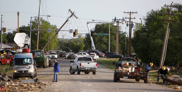 Utility lines hang over a street in Woodward, Okla., Sunday, April 15, 2012. A tornado that killed five people struck Woodward, Okla., shortly after midnight on Sunday, April 15, 2012.  Photo by Bryan Terry, The Oklahoman