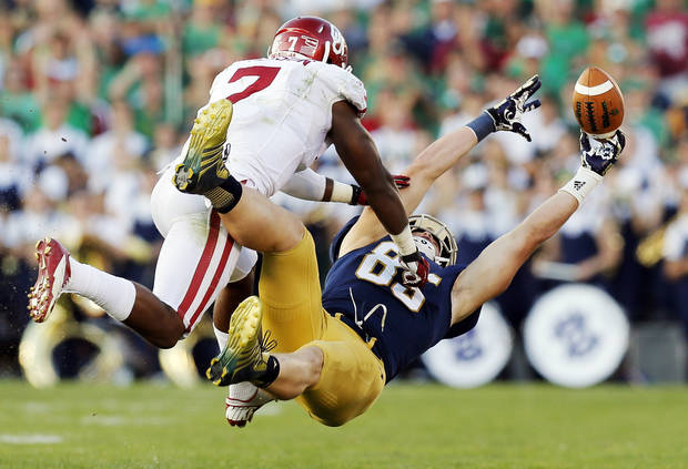 A pass intended for Notre Dame's Troy Niklas (85) falls incomplete in the fourth quarter as Oklahoma's Corey Nelson (7) defends during a college football game between the University of Oklahoma Sooners and the Notre Dame Fighting Irish at Notre Dame Stadium in South Bend, Ind., Saturday, Sept. 28, 2013. OU won, 35-21. Photo by Nate Billings, The Oklahoman