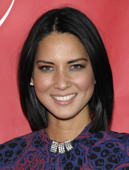 Actress Olivia Munn arrives at the NBC Universal 2011 Winter Press Tour party in Pasadena, Calif. on Thursday, Jan. 13, 2011. (AP Photo/Dan Steinberg) ORG XMIT: CADS111