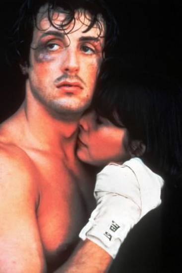 "Sylvester Stallone holds Talia Shire in a scene from 1976's ""Rocky."""