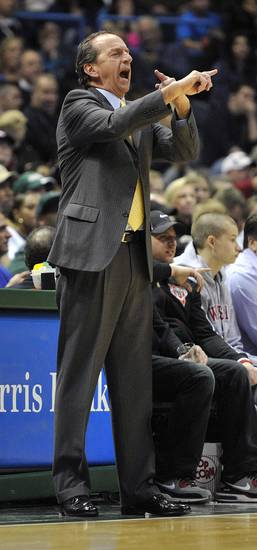 Milwaukee Bucks head coach Jim Boylan calls a play against the Washington Wizards during the first half of an NBA basketball game Monday, Feb. 11, 2013, in Milwaukee. (AP Photo/Jim Prisching)