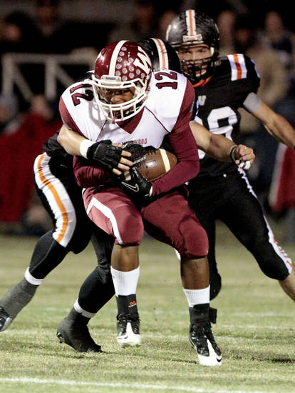 Wynnewood's Curtis Rushing (12) carries against Wayne's defense in high school Football on Friday, Oct. 26, 2012 in Wayne, Okla.  Photo by Steve Sisney, The Oklahoman