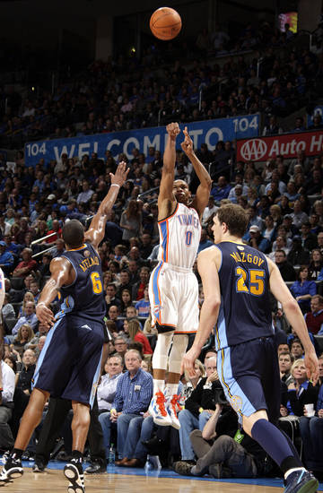Oklahoma City's Russell Westbrook (0) shoots as Denver's Arron Afflalo (6) and Timofey Mozgov (25) defend during the NBA basketball game between the Oklahoma City Thunder and the Denver Nuggets at the Chesapeake Energy Arena, Sunday, Feb. 19, 2012. Photo by Sarah Phipps, The Oklahoman