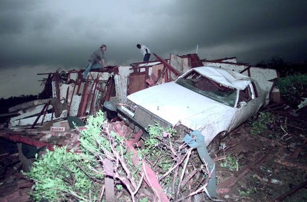 MAY 3, 1999 TORNADO: TORNADO DAMAGE: PEOPLE SEARCH FOR SURVIVORS IN THIS HOUSE  AFTER A TORNADO RIPS THREW MOORE OF OF 12TH AND SANTA FE.