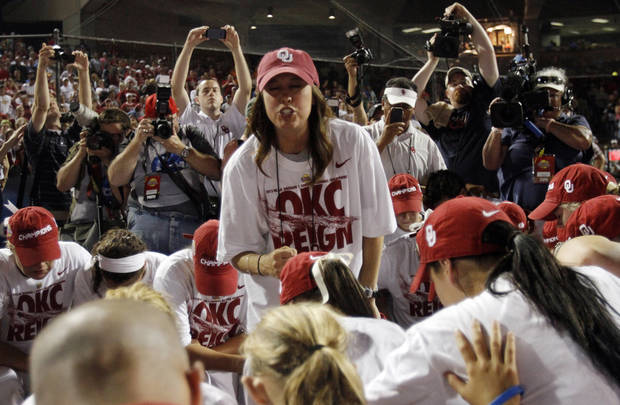 The Oklahoma softball team gathers for a team prayer after defeating Tennessee 4-0 on June 4, 2013 to win the NCAA championship. Photo by KT KING, The Oklahoman