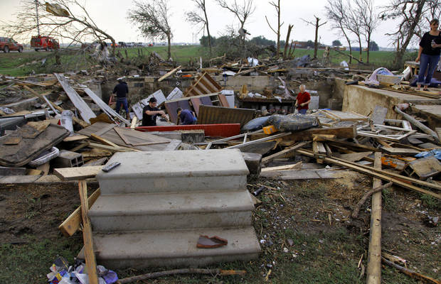 Steps are one of the few things left after a tornado destroyed the home of Tom Chronister north of El Reno, Tuesday, May 24, 2011. Photo by Chris Landsberger, The Oklahoman ORG XMIT: KOD