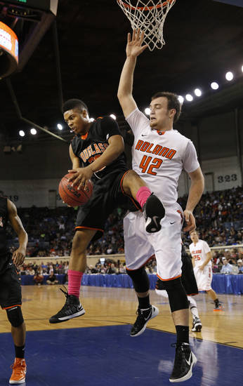 Douglass' Trevon Threatt gets a rebound in front of Austin Cantrell during the 4a boys championship game where the Douglass high school Trojans play the Roland Rangers at the State Fair Arena on Saturday, March 9, 2013 in Oklahoma City, Okla.  Photo by Steve Sisney, The Oklahoman