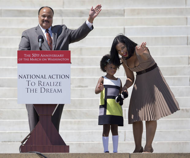 Martin Luther King III, his wife Arndrea King and daughter Yolanda wave from the steps of the Lincoln Memorial in Washington Saturday, Aug. 24, 2013, to the crowd gathered for the 50th anniversary commemoration of the Aug. 28, 1963, March on Washington.  (AP Photo/Carolyn Kaster)