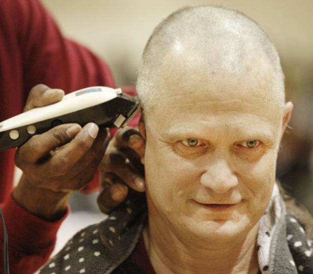 HIGH SCHOOL BASKETBALL / STATE CHAMPIONSHIP / CELEBRATE / CELEBRATION: Coach Scott Raper gets his head shaved during an assembly celebrating the Centennial boys state basketball championship in Oklahoma City , March 25 , 2011. Photo by Steve Gooch, The Oklahoman <strong>Steve Gooch</strong>