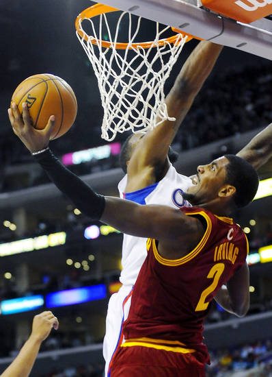 Cleveland Cavaliers guard Kyrie Irving (2) shoots a layup around Los Angeles Clippers center DeAndre Jordan, rear, in the first half of an NBA basketball game, Monday, Nov. 5, 2012, in Los Angeles. (AP Photo/Gus Ruelas)