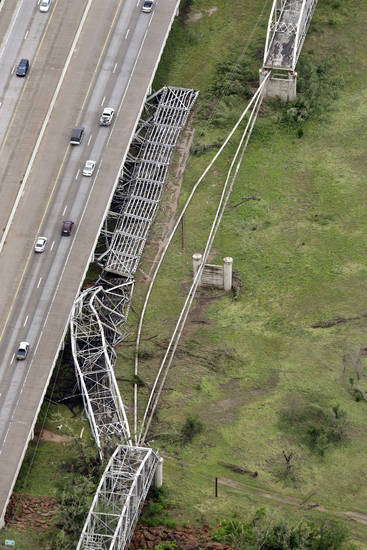 This aerial photo shows tornado damage to the old U.S. 62 bridge over the Canadian River near Newcastle. The bridge, which runs parallel to Interstate 44, has been closed to traffic since 1963. AP PHOTO BY TONY GUTIERREZ <strong>Tony Gutierrez</strong>