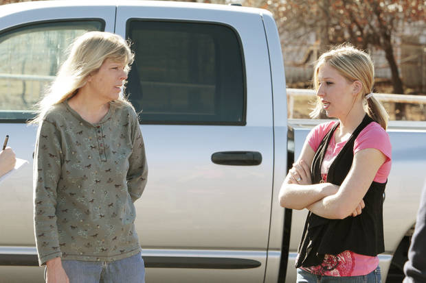 Sarah McKinley, 18, (right) talks with her mother Debbie Murray outside her rural home on Wednesday, Jan. 4, 2012, in Blanchard, Okla.  McKinley shot and killed an intruder who broke through the front door.  Photo by Steve Sisney, The Oklahoman ORG XMIT: KOD