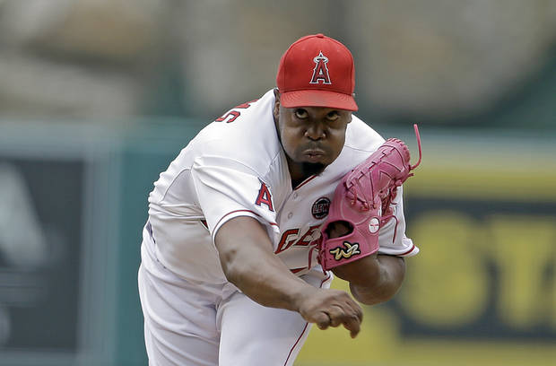 Los Angeles Angels starter Jerome Williams pitches to the Oakland Athletics in the first inning of a baseball game in Anaheim, Calif., Sunday, July 21, 2013. (AP Photo/Reed Saxon)
