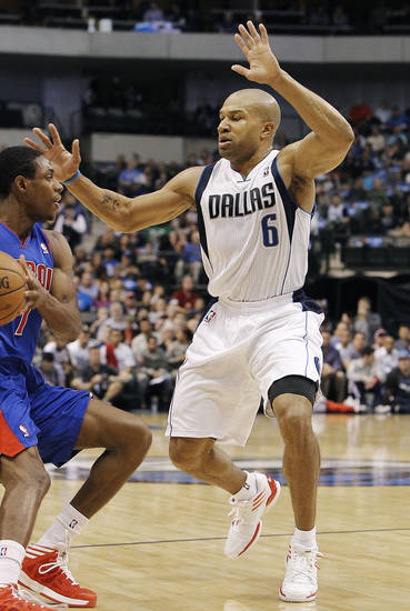 Detroit Pistons guard Brandon Knight (7) looks to pass the ball as Dallas Mavericks guard Derek Fisher (6) defends during the first half of an NBA basketball game in Dallas, Saturday, Dec. 1, 2012. (AP Photo/Brandon Wade)