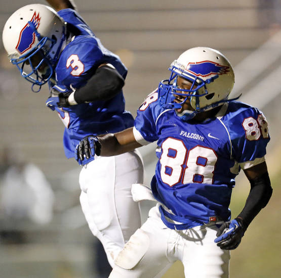 Millwood's Cameron Batson (3) and Dashawn Stephens (88) celebrate a touchdown by Stephens during a high school football game between Millwood and Prime Prep Academy in Oklahoma City, Friday, Sept. 14, 2012. Photo by Nate Billings, The Oklahoman