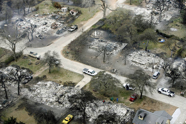 Fire destroyed a number of homes in this neighborhood near Hiwassee Rd. and SE 15th St. in Choctaw, OK, Friday, April 10, 2009. Photo by Paul Hellstern