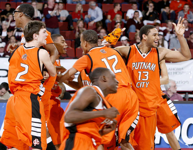 The Putnam City team celebrates it's win in the Class 6A boys championship game between Putnam City and Jenks in the Oklahoma High School Basketball Championships at Lloyd Noble Arena in Norman, Okla., Saturday, March 14, 2009. PHOTO BY BRYAN TERRY, THE OKLAHOMAN