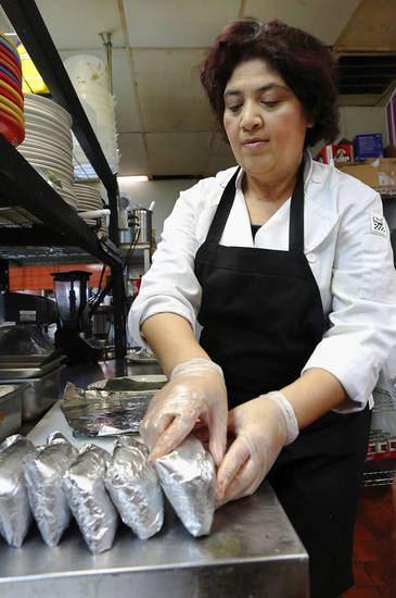 Veronica Del Cid prepares Guatemalan-style tamales at Cafe Kacao in Oklahoma City. <strong>Jim Beckel - THE OKLAHOMAN</strong>
