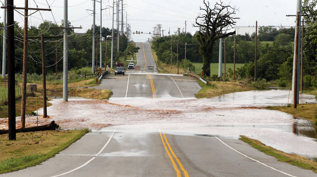 Water was still over the roadway south of Moore Norman Technology Center at 8:00 am. on Saturday, June 1, 2013 in Norman, Okla.  Many roads in the area were closed because of flood water during Friday night's storm.  Photo by Steve Sisney, The Oklahoman