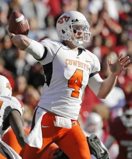 OSU's  Brandon  Weeden (4) passes in the fourth quarter of the Bedlam college football game between the University of Oklahoma Sooners (OU) and the Oklahoma State University Cowboys (OSU) at the Gaylord Family -- Oklahoma Memorial Stadium on Saturday, Nov. 28, 2009, in Norman, Okla. OU won, 27-0. Photo by Nate Billings