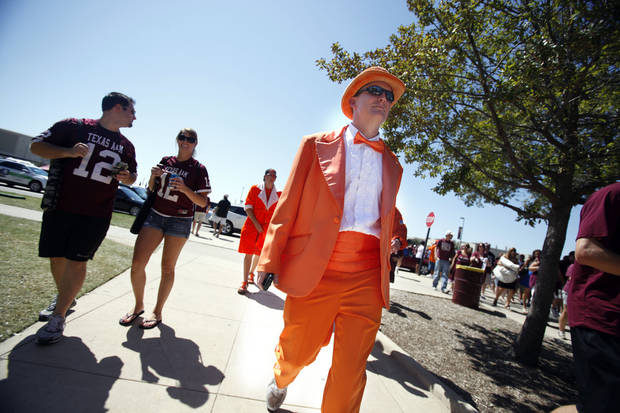 Oklahoma State Fan Philip Parr walk to the stadium before the Cowboys played Texas A&M in College Station, Texas on Saturday. Photo by Sarah Phipps, The Oklahoman