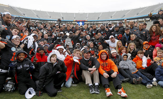 The Oklahoma State football poses for a photo after the Heart of Dallas Bowl football game between Oklahoma State University and Purdue University at the Cotton Bowl in Dallas, Tuesday, Jan. 1, 2013. Oklahoma State won 58-14. Photo by Bryan Terry, The Oklahoman