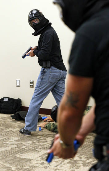 Law enforcement officers clear the scene after a simulated school shooting in a training exercise Tuesday at the Moore Norman Technology Center. PHOTO BY STEVE SISNEY, THE OKLAHOMAN <strong>STEVE SISNEY</strong>