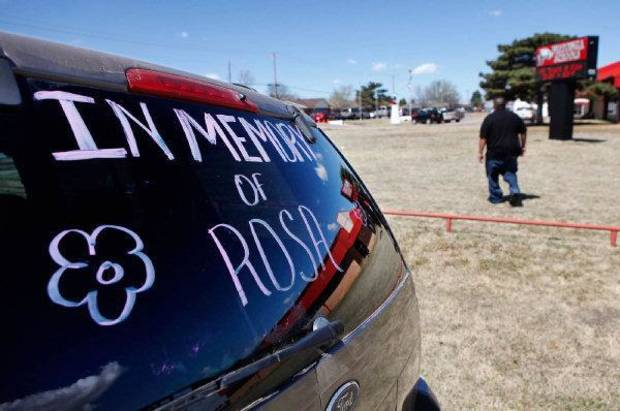 An SUV's rear window features a memorial to Rosalin Reynolds, 8, who was fatally stabbed last week in Watonga. Her funeral service was Thursday. <strong>JIM BECKEL - The Oklahoman</strong>