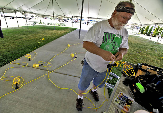 Darrell Pearman connects lights during setup for the Arts Festival Oklahoma at Oklahoma City Community College on Tuesday, Aug. 31, 2010, in Oklahoma City, Okla.  Photo by Chris Landsberger, The Oklahoman