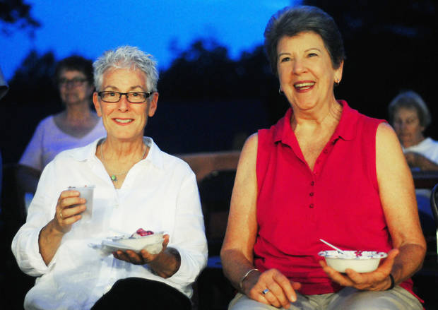 Pat Darlington (left) and Kay Stewart (right) were instrumental in the founding of the Oakcreek Cohousing Community community in Stillwater, Okla. Residents of the community gathered on Sept. 12 to eat ice cream and listen to live music. Photo by KT King/For the Oklahoman