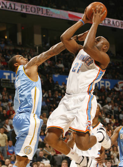J.R Smith tries to stop Damien Wilkins in the first half as the Oklahoma City Thunder play the Denver Nuggets at the Ford Center in Oklahoma City, Okla. on Friday, January 2, 2009.  Photo by Steve Sisney/The Oklahoman