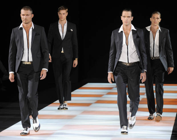 Models take the runway during the Emporio Armani Spring 2010 men's collection, presented in Milan, Italy.