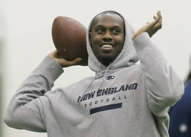 New England Patriots defensive end Chandler Jones throws a pass prior to a NFL football practice in Foxborough, Mass., Wednesday, Dec. 26, 2012. The Patriots host the Miami Dolphins on Sunday. (AP Photo/Elise Amendola)