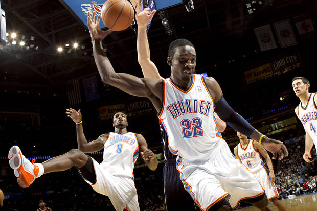 Oklahoma City's Jeff Green (center) Serge Ibaka, Eric Maynor and Nick Collison combine to chase down a loose ball against Atlanta during their NBA basketball game at the OKC Arena in Oklahoma City on Friday, Dec. 31, 2010. The Thunder beat the Hawks 103-94. Photo by John Clanton, The Oklahoman