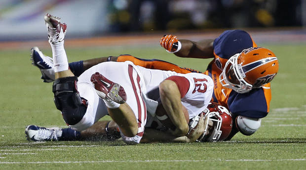 Oklahoma Sooners quarterback Landry Jones (12) is sacked by UTEP's DeAndre Little (53) during the college football game between the University of Oklahoma Sooners (OU) and the University of Texas El Paso Miners (UTEP) at Sun Bowl Stadium on Sunday, Sept. 2, 2012, in El Paso, Tex.  Photo by Chris Landsberger, The Oklahoman