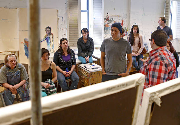 Artist Yatika Fields, a Stillwater native, talks March 29 with students at Oklahoma State University. Fields is teaming up with OSU students to create a series of murals for a live painting event Friday. Photo by Bryan Terry, The Oklahoman <strong>Bryan Terry</strong>