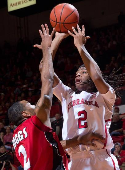 Nebraska's David Rivers (2) scores over Jacksonville State's Ronnie Boggs (2) during the first half of an NCAA college basketball game Tuesday, Dec. 18, 2012, in Lincoln, Neb. Nebraska defeated Jacksonville State 59-55. (AP Photo/The Omaha World-Herald, Mark Davis) MAGS OUT  LOCAL TV OUT