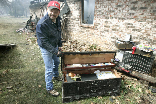 Roy Ericksen show that the contents of his daughter cedar chest survived even though her home at 14244 NE 5th was destroyed in a wildfire in Choctaw, Oklahoma April 10, 2009.  Photo by Steve Gooch, The Oklahoman
