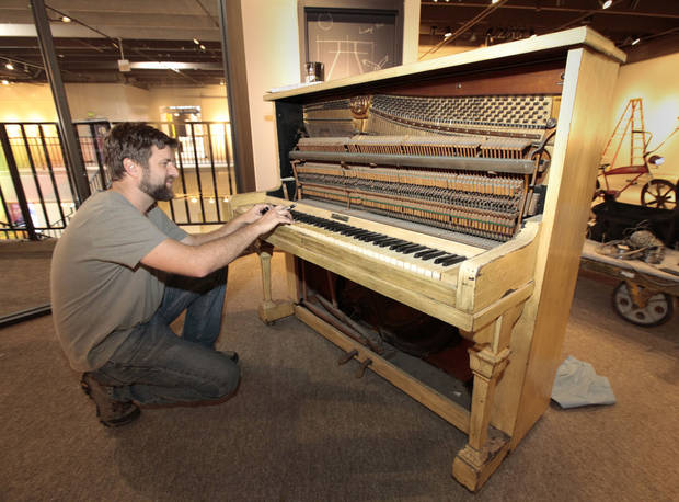 "Scott Henderson tests a piano that  visitors will be invited to decorate for ""Soundscapes"" at Science Museum Oklahoma. Photo By David McDaniel The Oklahoman <strong>David McDaniel - The Oklahoman</strong>"