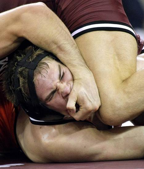 OU / OSU / BEDLAM / COLLEGE WRESTLING / OKLAHOMA STATE UNIVERSITY: Oklahoma State's Dallas Bailey wrestles with Oklahoma's Tyler Caldwell (top) during their dual at McCasland Field House on the University of Oklahoma campus in Norman, Okla., on Sunday, Feb. 20, 2011. Tyler Caldwell won this match. Oklahoma State won the dual 24-9. Photo by John Clanton, The Oklahoman ORG XMIT: KOD