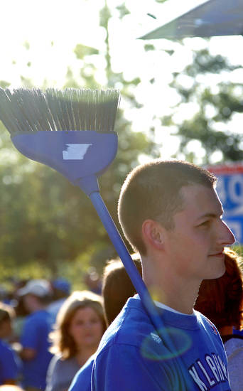 Thunder fan Casey Elsen, of Wichita, Kan., carries his broom as he looks for a Thunder sweep of the Lakers during Game 2 in the second round of the NBA playoffs between the Oklahoma City Thunder and the L.A. Lakers at Chesapeake Energy Arena on Tuesday,  May 15, 2012, in Oklahoma City, Oklahoma. Photo by Chris Landsberger, The Oklahoman