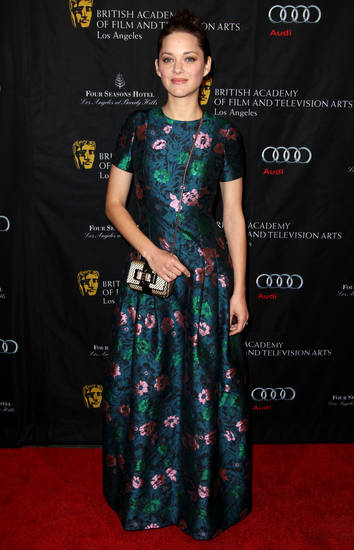 Actress Marion Cotillard arrives at the BAFTA Awards Season Tea Party at The Four Seasons Hotel on Saturday, Jan. 12, 2013, in Los Angeles. (Photo by Matt Sayles/Invision/AP)