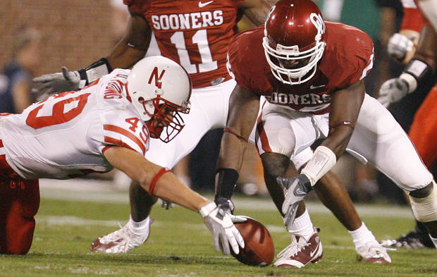 Oklahoma's Keenan Clayton (22) goes after a fumble he forced on Nebraska's Dreu Young (49) during the first half of the college football game between the University of Oklahoma Sooners (OU) and the University of Nebraska Huskers (NU) at the Gaylord Family-Oklahoma Memorial Stadium, on Saturday, Nov. 1, 2008, in Norman, Okla. 