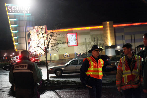 Authorities stand by in the parking lot of Clackamas Town Center in Portland, Ore., Tuesday, Dec. 11, 2012. A gunman opened fire in the suburban Portland shopping mall Tuesday, killing two people and wounding another as people were doing their Christmas shopping, authorities said. (AP Photo/Statesman-Journal, Thomas Patterson)