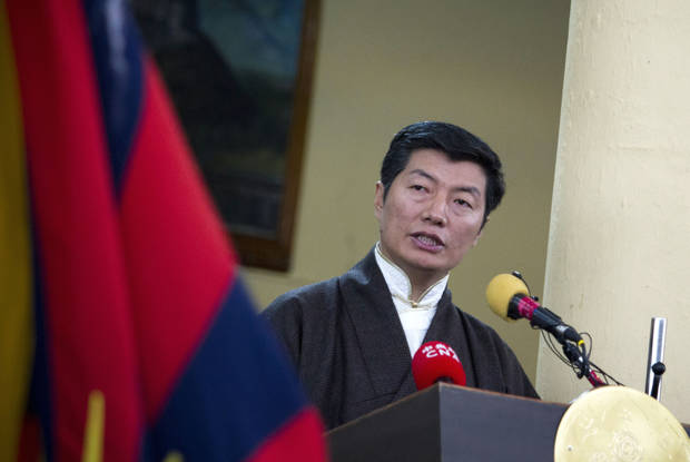 Lobsang Sangay, the prime minister of the Tibetan government-in-exile addresses a gathering in Dharmsala, India, as Tibetan exiles mark the anniversary of a failed 1959 uprising against Chinese rule, Sunday, March 10, 2013. Police in India prevented a Tibetan man from setting himself on fire as hundreds of Tibetan exiles gathered to mark the anniversary in Dharmsala, the home of Tibet's government in exile. (AP Photo/ Ashwini Bhatia)